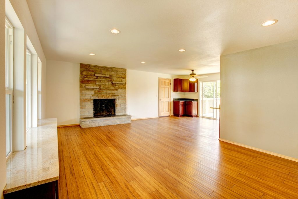 an empty house with fireplace